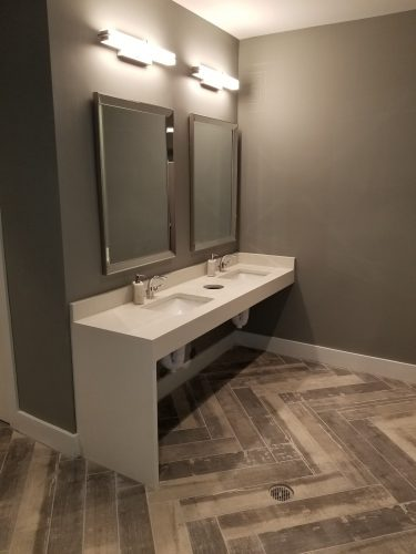 amenity renovation fitness center gym painting flooring lighting countertop faucet mirror