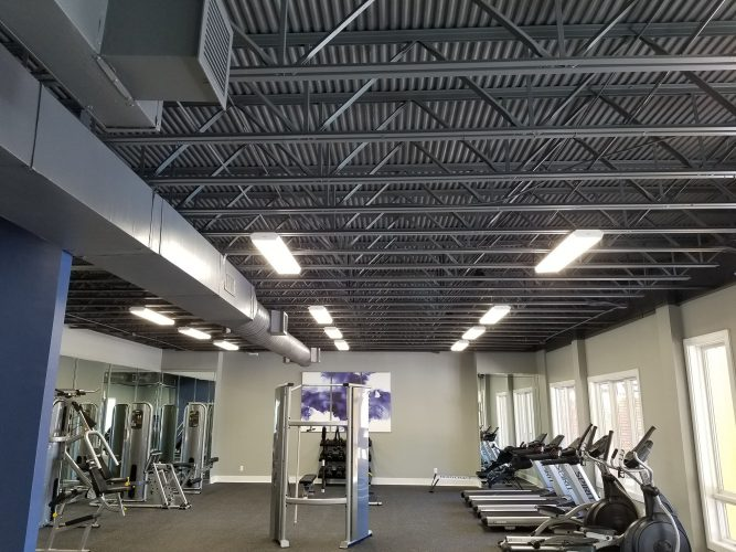 amenity renovation fitness center gym painting flooring lighting rafters hvac