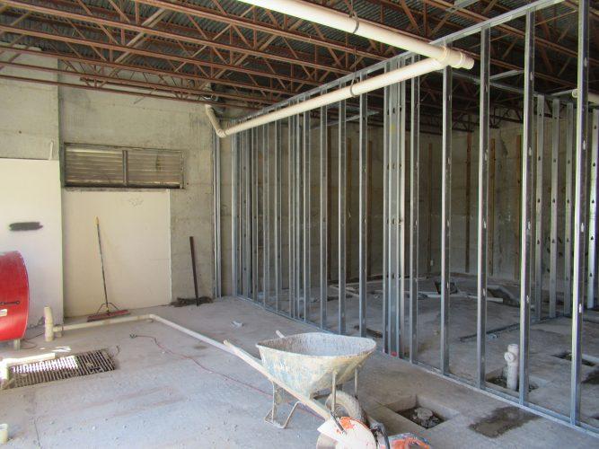 amenity renovation fitness center gym painting flooring lighting studs plumbing