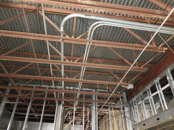 amenity renovation fitness center gym rafters conduit
