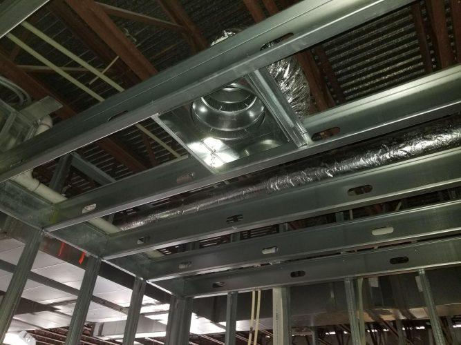 amenity renovation fitness center gym rafters hvac studs