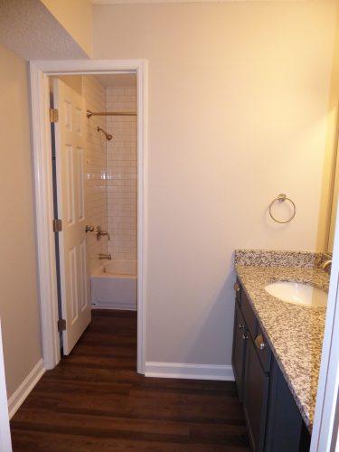 apartment bathroom bath hardware countertop paint subway tile shower renovation