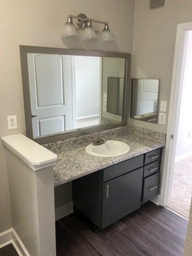 apartment bathroom mirror vanity light countertop faucet renovation