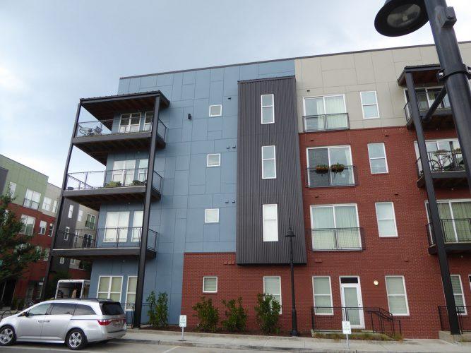 apartment exterior paint renovation corner of building balconies