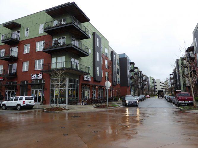 apartment exterior paint renovation corner of building street view