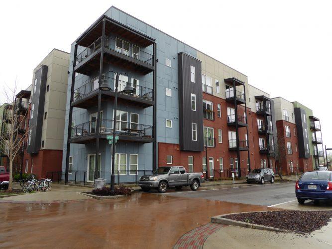 apartment exterior paint renovation corner of building street view(1)