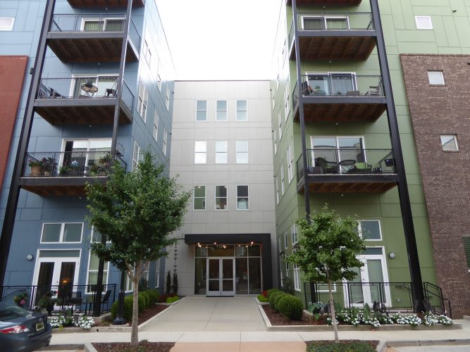 apartment exterior paint renovation leasing office entry balconies