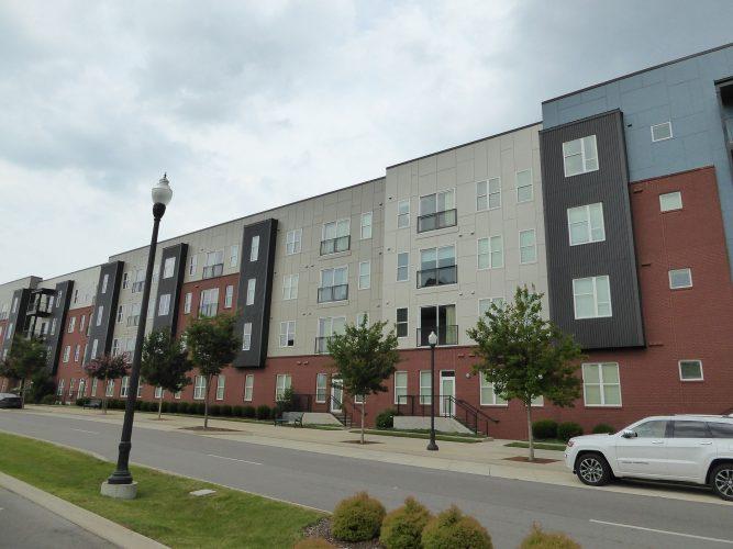 apartment exterior paint renovation street view length of building