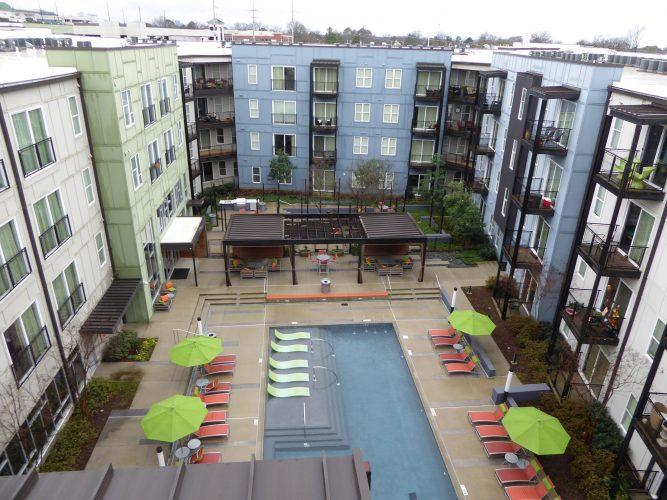 apartment exterior pool area pergola paint renovation