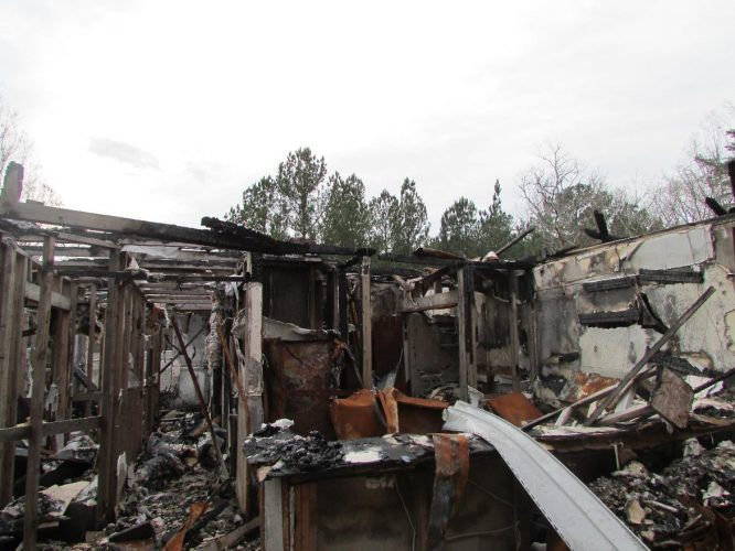apartment fire damage completely burned building remediation