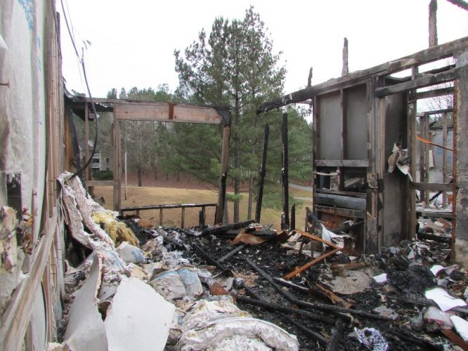 apartment fire damage completely burned building remediation(1)