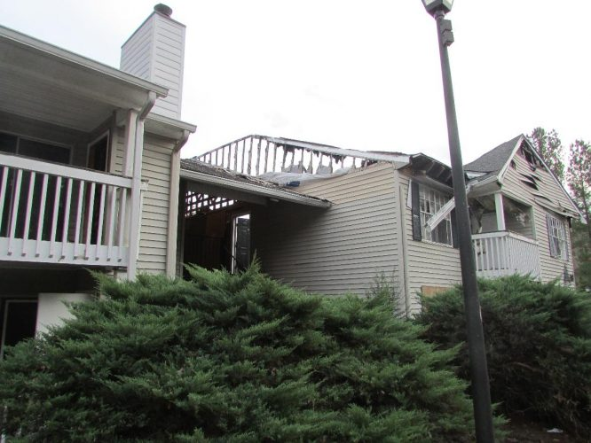 apartment fire damage exterior roof siding balcony remediation