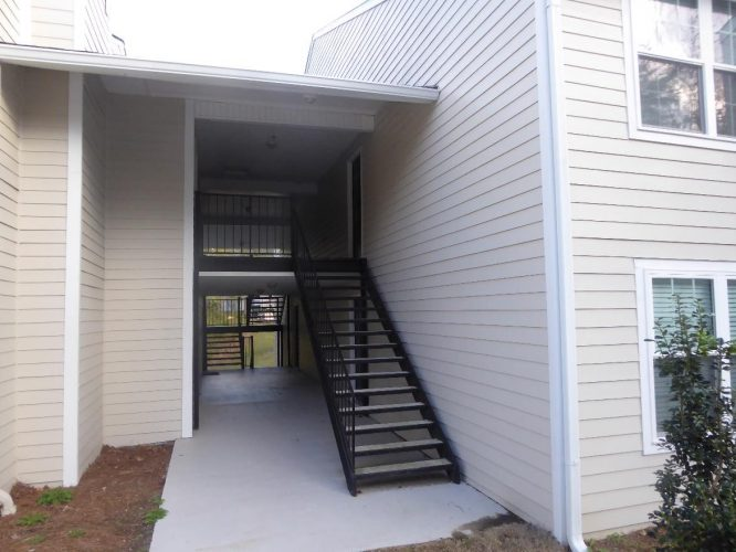 apartment fire damage exterior siding breezeway stairs remediation