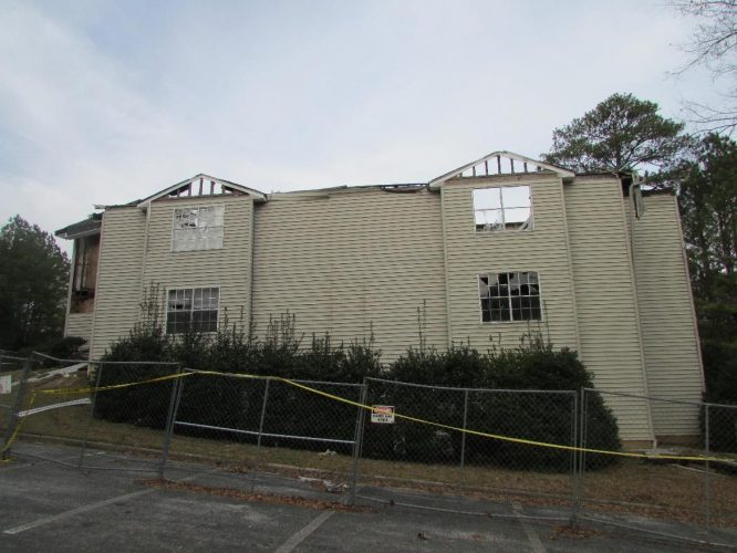 apartment fire damage exterior siding roof remediation