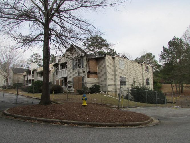 apartment fire damage exterior siding roof remediation(1)