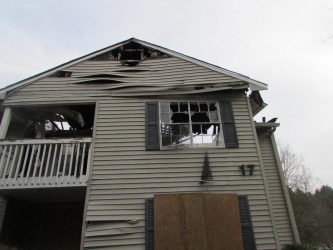 apartment fire damage exterior siding roof windows remediation