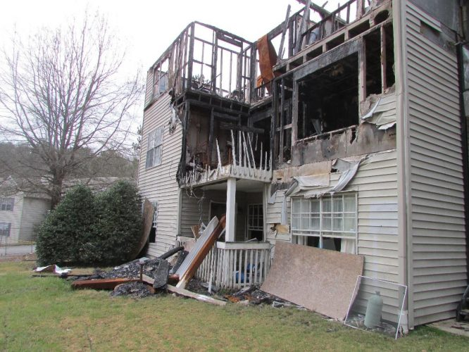 apartment fire damage exterior studs balcony roof remediation