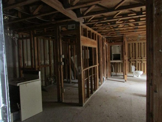 apartment fire damage interior framing complete remediation