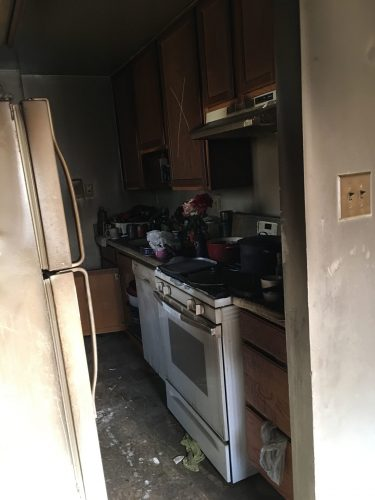 apartment fire damage interior kitchen remediation