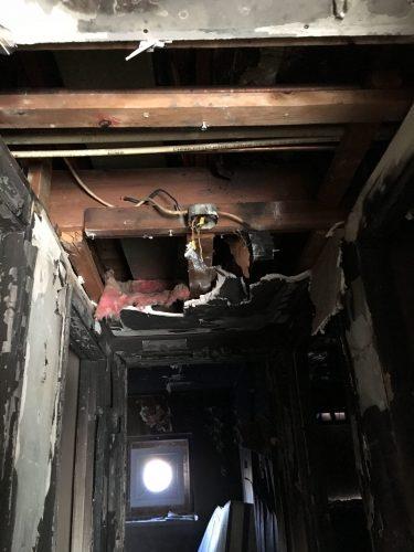 apartment fire damage studs insulation sheetrock remediation