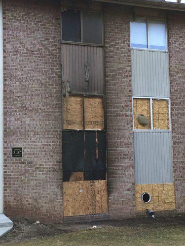apartment fire exterior siding window remediation