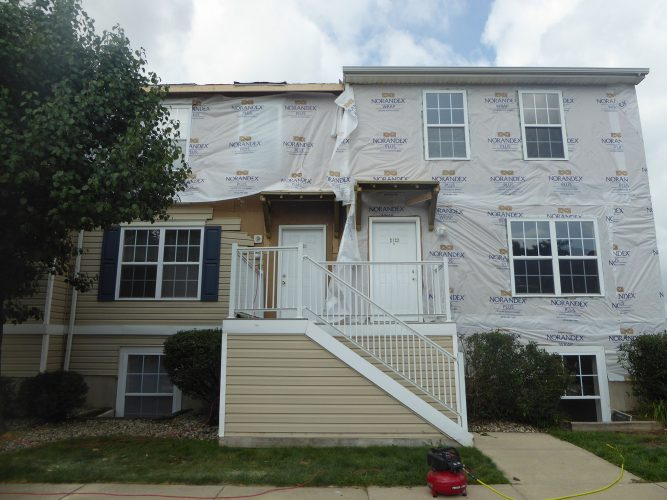 apartment hardie siding paint porch in progress renovation (1)