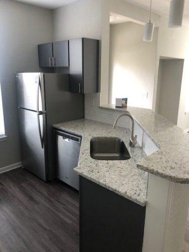 apartment kitchen appliances countertop cabinet renovation