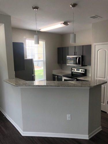 apartment kitchen countertop cabinet light appliances renovation