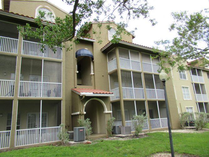 apartment stucco entry breezeway balcony paint exterior renovation