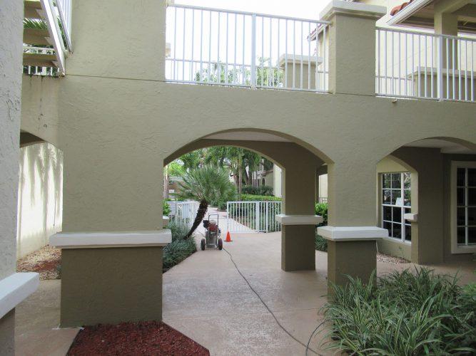 apartment stucco paint exterior breezeway catwalk renovation